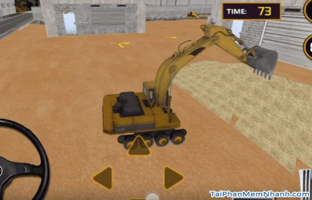 xúc cát bằng máy xúc để vận chuyển ra xe
