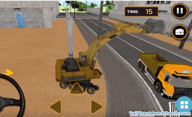 đổ cát từ máy xúc máy cẩu vào xe tải